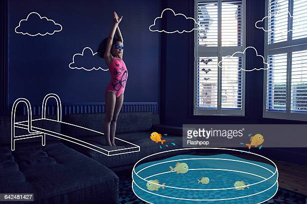 gir diving into imaginary pool - vorstellungskraft stock-fotos und bilder