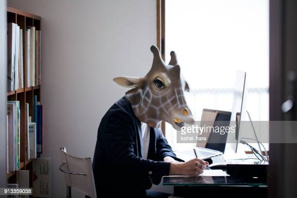 Giraffe head man working from home
