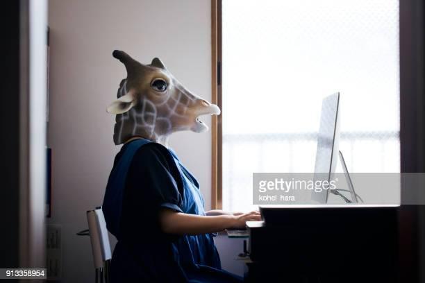 Giraffe head woman working from home
