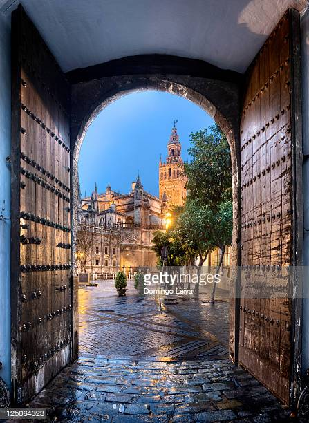 giralda from los reales alcazares, sevilla spain - seville stock pictures, royalty-free photos & images