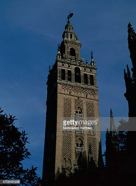 'Giralda's minaret by Almohad craftsmen 11841198 12th and 16th Century masonry Spain Seville Whole artwork view Sight of the western facade of the...