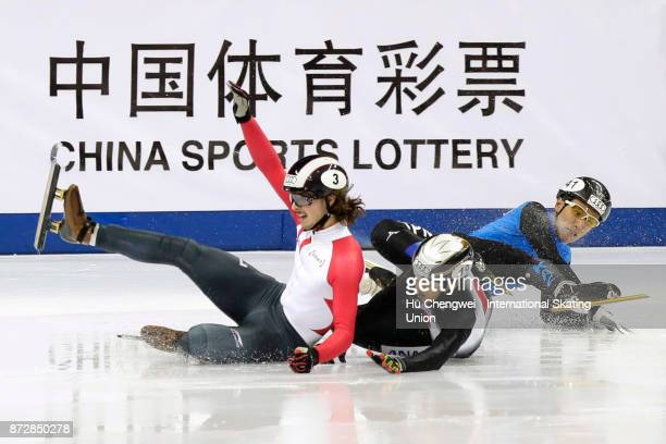Girard Samuel of Canada Zhumagaziyev Nurbergen of Kazakhstan and Watanabe Keita of Japan crash during the Audi ISU World Cup Short Track Speed...