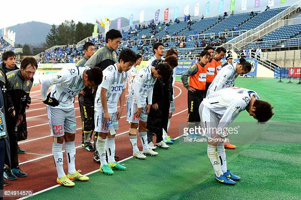 Giravanz Kitakyushu players bow for apology to supporters after their team's 03 defeat and relegation to the third division after the JLeague second...