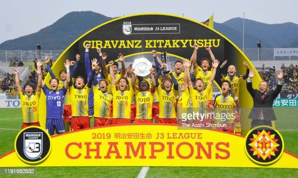 Giravanz Kitakyushu players celebrate their J3 Champions and promotion to the J2 after the J.League J3 match between Giravanz Kitakyushu and Gainare...