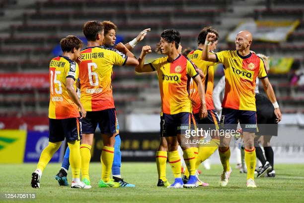 Giravanz Kitakyushu players celebrate their victory after during the JLeague Meiji Yasuda J2 match between Giravanz Kitakyushu and FC Ryukyu at...