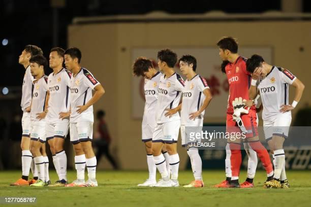 Giravanz Kitakyushu players show their dejection after the J.League Meiji Yasuda J2 match between Tokyo Verdy and Giravanz Kitakyushu at Ajinomoto...