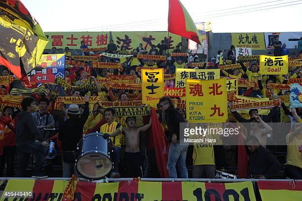 Giravanz Kitakyushu supporters hold mufflers prior to the JLeague second division match between Yokohama FC and Giravanz Kitakyushu at Nippatsu...
