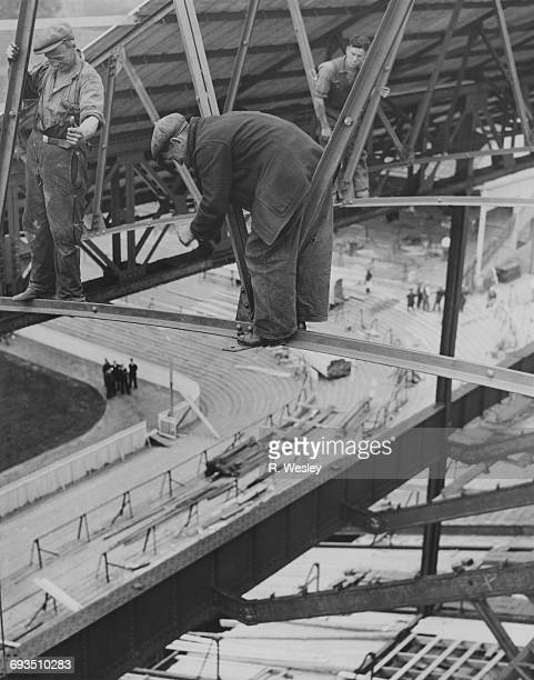 Girder men working on the roof of the new East Stand development at Tottenham Hotspur's White Hart Lane ground London 17th July 1934