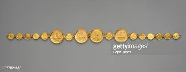 Girdle with Coins and Medallions Byzantine ca 583 reassembled after discovery Byzantine Settings gold sheet wire beaded Coins gold stamped Overall 26...