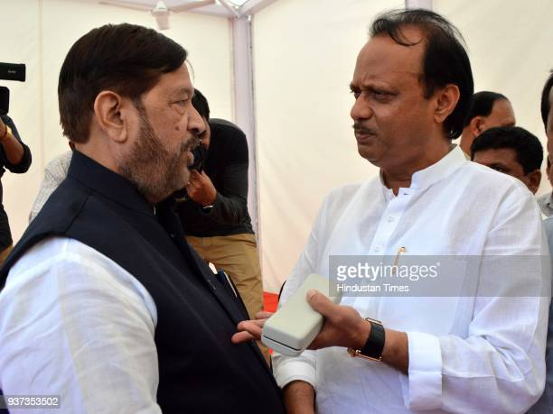 Girish Bapat interacts with Ajit Pawar during the budget session at Vidhan Bhavan on March 23 2018 in Mumbai India