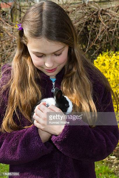 girl, 10 years old, with a pet rabbit, bavaria, germany, europe - 10 11 years stock pictures, royalty-free photos & images