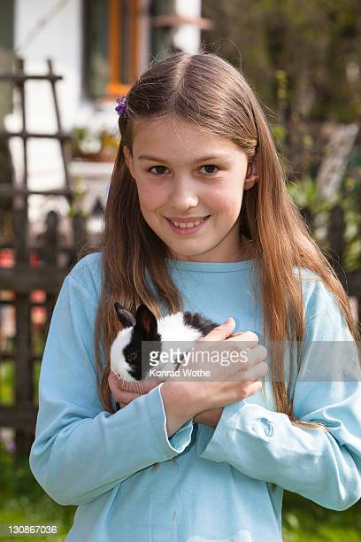 girl, 10 years old, with pet rabbit - 10 11 years stock pictures, royalty-free photos & images