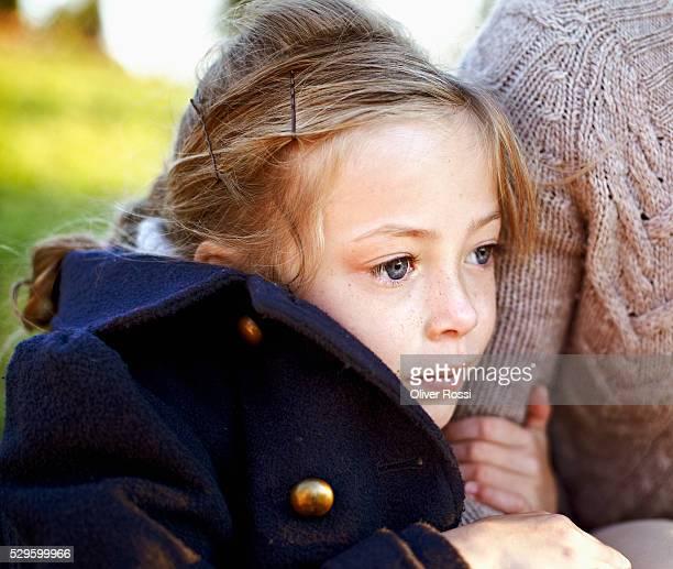 Girl [4-5] hugging mother