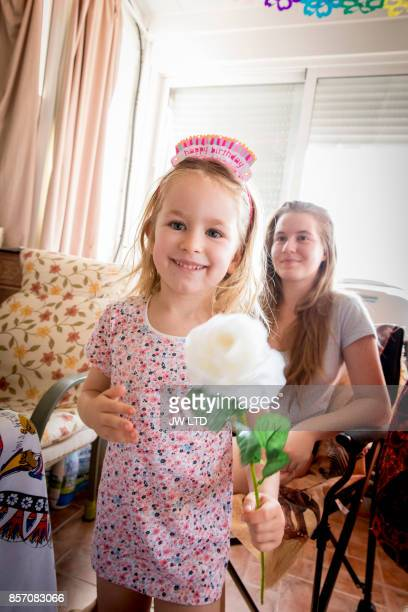 girl 4-5 years holding white rose - 4 5 years stock pictures, royalty-free photos & images