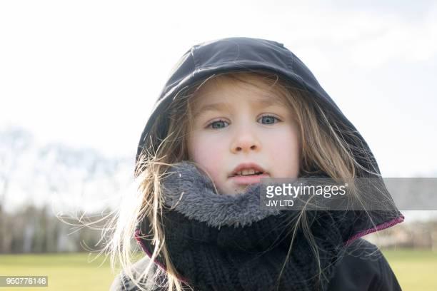 Girl 4-5 years in portrait in public park