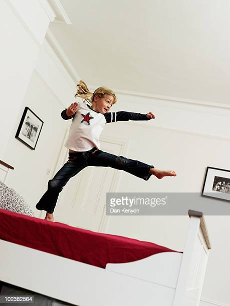 girl 6 years jumping on bed - 6 7 years stock pictures, royalty-free photos & images