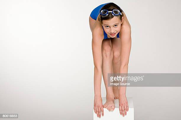 a girl about to dive - little girls bent over stock photos and pictures