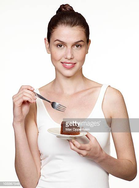 girl about to eat a slice of chocolate cake