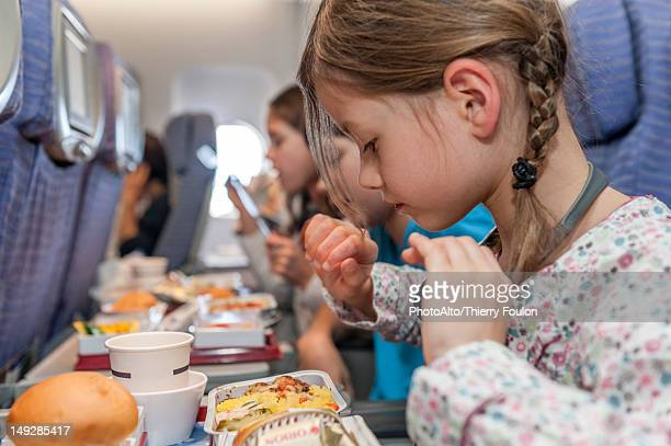 Girl about to eat airline meal