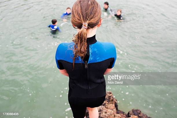 girl about to jump into water - sea swimming stock pictures, royalty-free photos & images