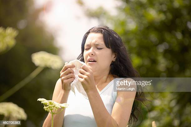 girl about to sneeze into tissue - sneezing stock pictures, royalty-free photos & images