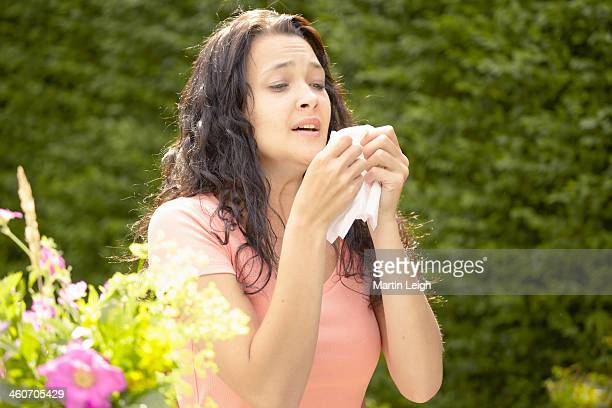 Girl about to sneeze into tissue