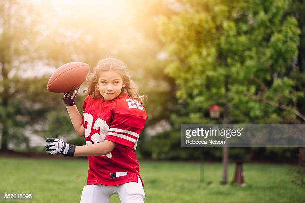 girl about to throw football