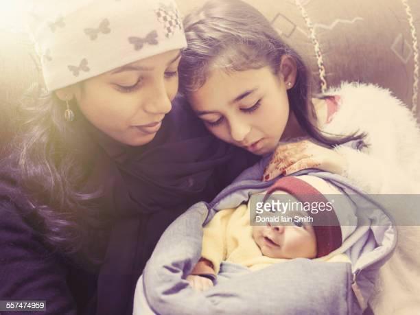 Girl admiring baby nephew with aunt