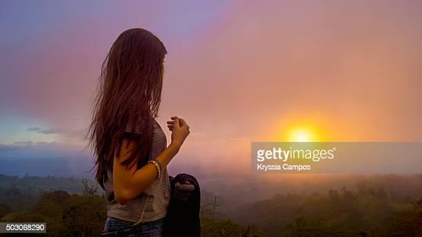 Girl admiring Mountain View at Sunset