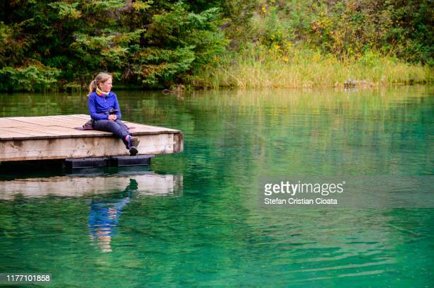 girl admiring the lake in jasper national park - national landmark stock pictures, royalty-free photos & images