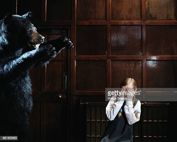 Girl afraid of stuffed bear