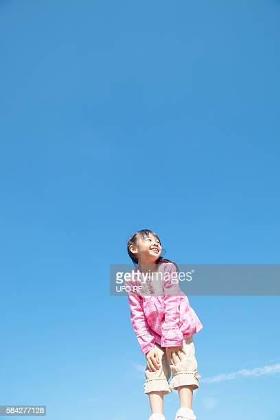 Girl Against Blue Sky