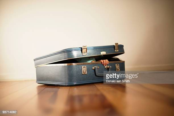 Girl aged four hides inside a small suitcase