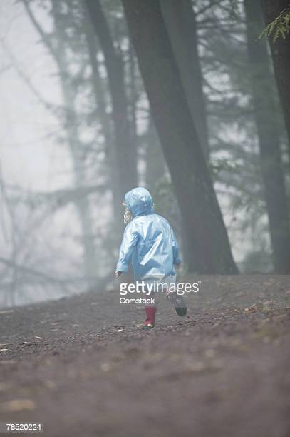 Girl alone in forest