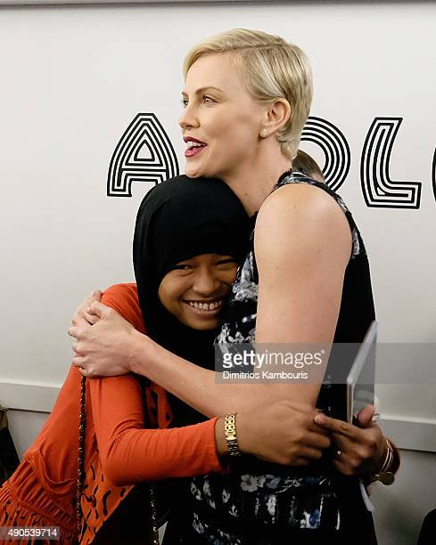 Girl ambassador from Plan International Nurfahada and Founder of Charlize Theron Africa Outreach Project and UN Messenger of Peace Charlize Theron...