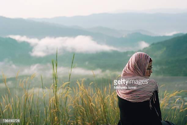 Girl among mountains