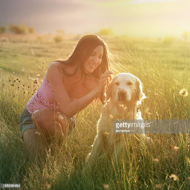 girl and a dog in nature