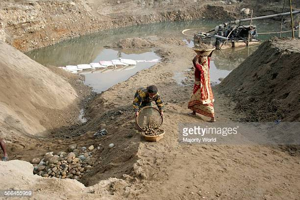 A girl and a woman working at a stone quarry on the bank of Dauki river Sylhet Bangladesh January 18 2010