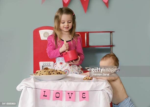 Girl and baby make cookies