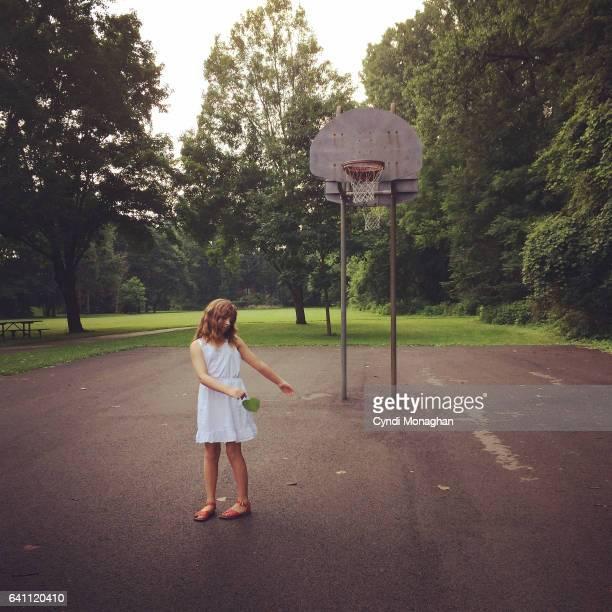 Girl and Basketball Court