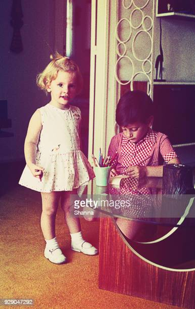 girl and boy brothers drawing at home - archival photos stock photos and pictures