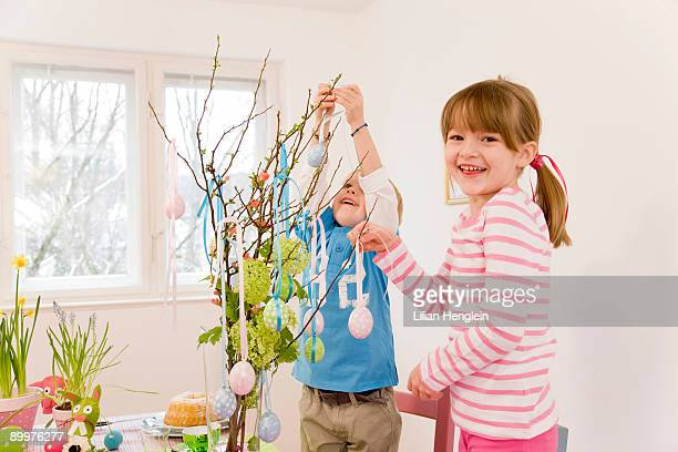 girl and boy decorate easter table