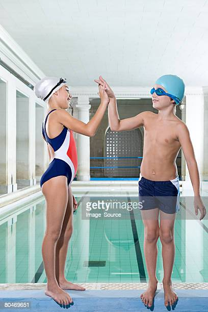 A girl and boy high fiving