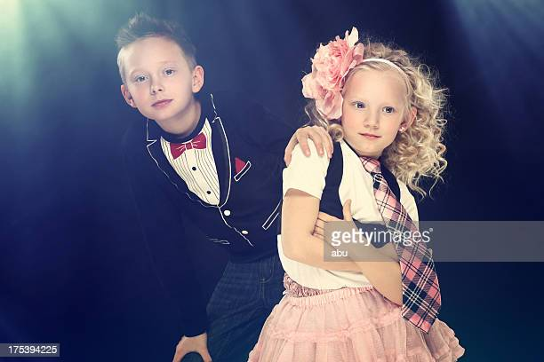 Girl and boy in flash light