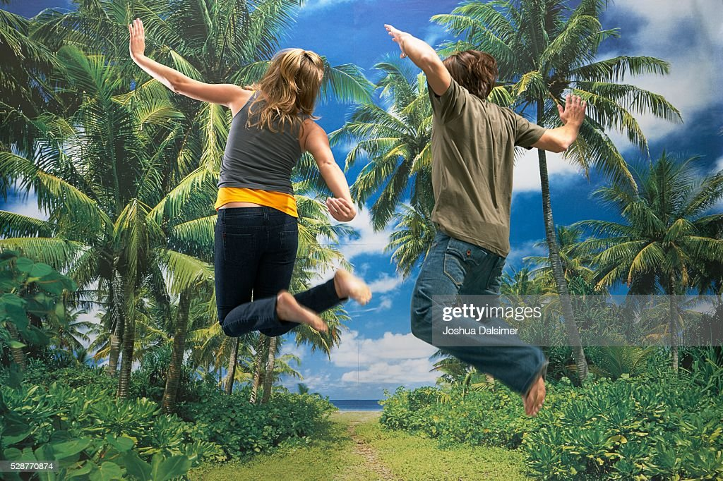 Girl and boy jumping : Stock Photo