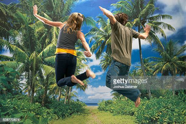 Girl and boy jumping