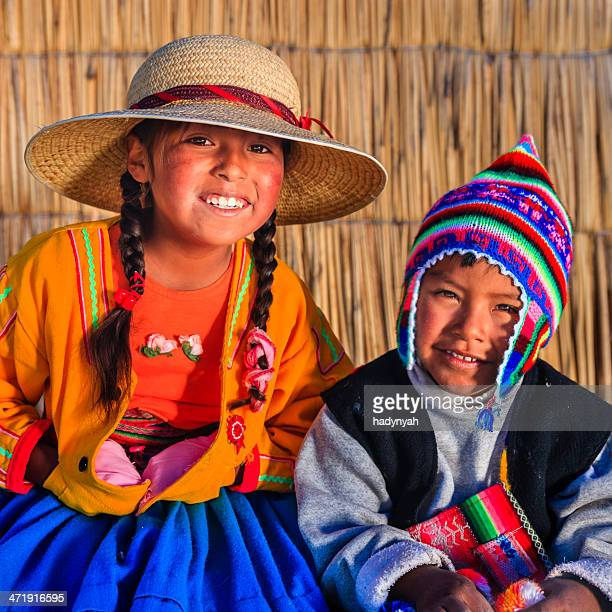 Girl and boy on Uros floating island, Lake Tititcaca, Peru