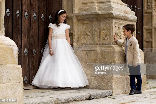 Girl and boy outside church before first communion
