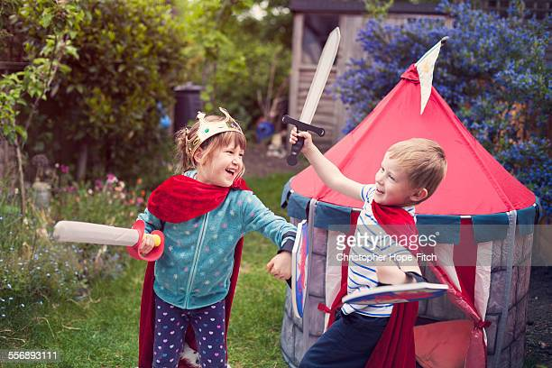 girl and boy play fighting - misbehaviour stock pictures, royalty-free photos & images