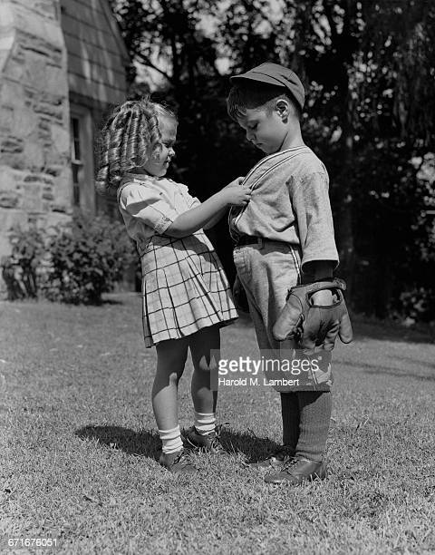 girl and boy playing in garden - {{relatedsearchurl(carousel.phrase)}} stock pictures, royalty-free photos & images